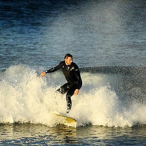 Michael Hesterberg of TaylorMade catches a wave while surfing at South Ponto State Beach in Carlsbad area near San Diego, CA.