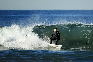 Christopher Piniarski of TaylorMade catches a wave while surfing at South Ponto State Beach in Carlsbad area near San Diego, CA.