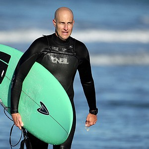 Eric Loper of TaylorMade leaves the water after surfing at South Ponto State Beach in Carlsbad area near San Diego, CA.