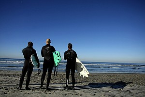 TaylorMade Golf industry guys from left to right, Christopher Piniarski, Eric Loper and Scott Mayers look at the waves South Ponto State Beach in Carlsbad area near San Diego, CA.