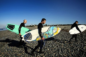 TaylorMade Golf industry guys from left, Eric Loper, Scott Mayers, and Christopher Piniarski leave the beach after surfing at South Ponto State Beach in Carlsbad area near San Diego, CA.