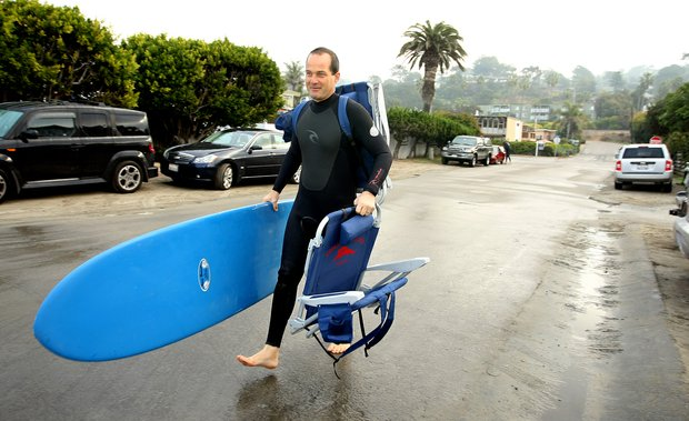 Carl Pettersen of Lamkin Grips heads to the beach to surf in the Del Mar area of San Diego and set up camp for his family to arrive later.
