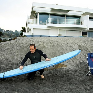 Carl Pettersen of Lamkin Grips preparing his board for surfing in Del Mar area of San Diego.