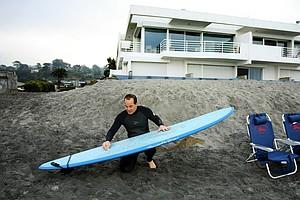 Carl Pettersen of Lamkin Grips preparing his board for surfing in Del Mar area of San Diego.