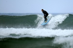 Carl Pettersen of Lamkin Grips surfing in Del Mar area of San Diego.