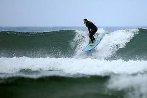 Carl Pettersen of Lamkin Grips surfing in Del Mar area of San Diego.