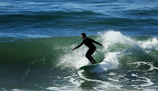 Eric Loper of TaylorMade surfing during lunch break near Carlsbad.