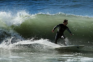 Scott Mayers of TaylorMade surfing during lunch break near Carlsbad.