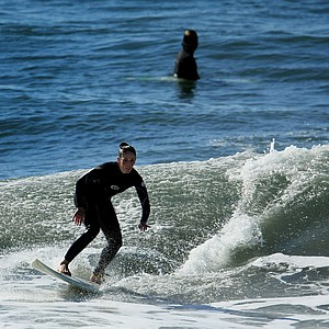 -Michelle Penney of TaylorMade surfing during lunch break near Carlsbad.