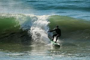 Maresala Milo of TaylorMade surfing during lunch break near Carlsbad.