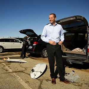 Dan Barelmann of TaylorMade gets dressed to head back to work after surfing during lunch break near Carlsbad.