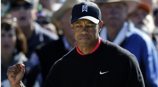 Tiger Woods pumps his fist during the Farmers Insurance Open.