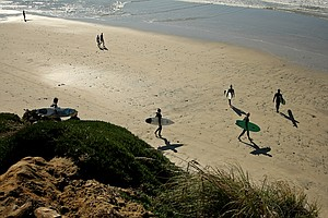 TaylorMade employees Michelle Penney, Maresala Milo, Eric Loper, Dan Barelmann, Josh Dipert and Scott Mayers head to the water for a little surfing during lunch break near Carlsbad.