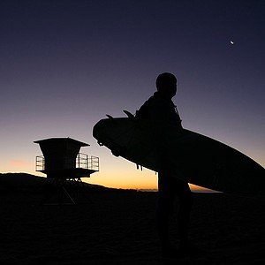 Dave Ortley of Oakley looks over the surf before heading in the freezing waters in the Trestles area of Sam Clemente.