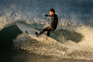 Gregg Hemphill of Oakley catches a wave while surfing in the Trestles area of San Clemente.