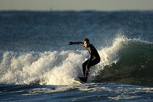 Gregg Hemphill of Oakley surfing in the Trestles area of San Clemente.