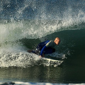 Dave Ortley of Oakley catches a wave while surfing in the Trestles area of San Clemente.