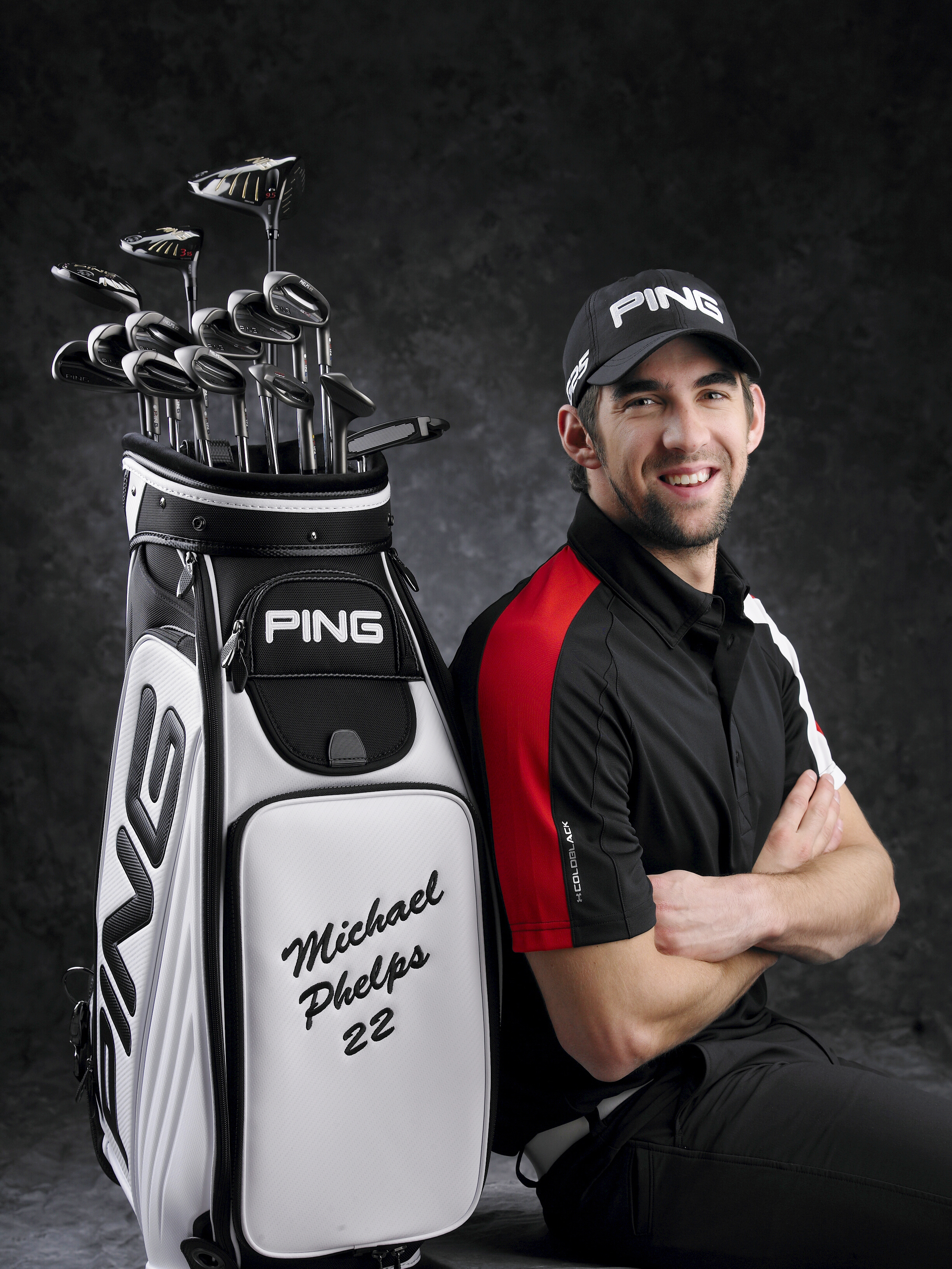 Michael Phelps with his Ping staff bag.