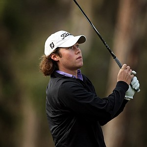 Michael Miller watches his tee shot during the 2013 Jones Cup Invitational at Ocean Forest.