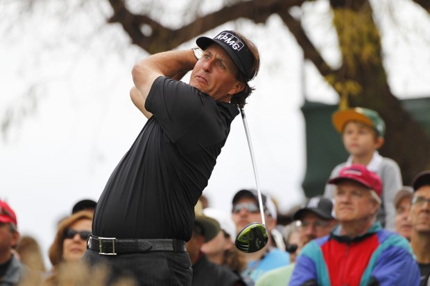 Phil Mickelson hits his tee shot on the third hole during the final round of the Waste Management Phoenix Open.
