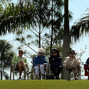 Spectators sit around No. 1 to catch a glimse of Arnold Palmer and Jack Nicklaus during the Devon Quigley Pro-Am at the Floridian. Proceeds from the event are going to benefit the Devon Quigley Special Needs Trust.