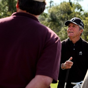 Gary Player talks with a few spectators on the range prior to the Devon Quigley Pro-Am at the Floridian. Player, Arnold Palmer and Jack Nicklaus headlined the benefit to raise money for Dana Quigley's son.