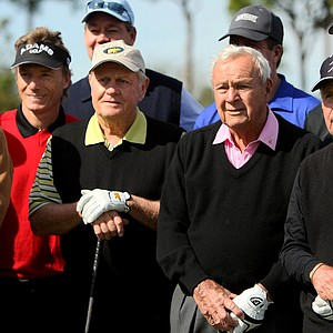 Legends, Jack Nicklaus, Arnold Palmer and Gary Player gather with a larger group for a picture prior to the Devon Quigley Pro-Am at the Floridian.