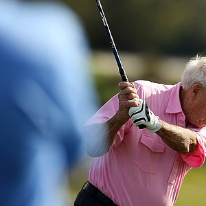 Arnold Palmer hits his tee shot at No. 18 during the Devon Quigley Pro-Am at the Floridian.