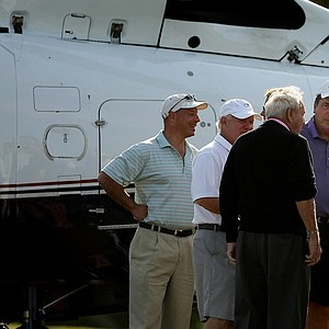 Baseball legend Johnny Bench chats with Arnold Palmer before Palmer hopped into a helicopter to leave the Devon Quigley Pro-Am at the Floridian.