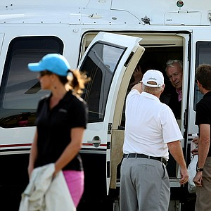 Arnold Palmer, center, left the Floridian Golf and Yacht Club in a helicopter after playing in the Devon Quigley Pro-Am at the Floridian.