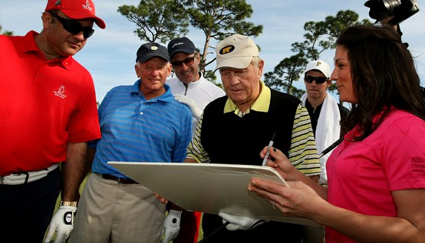 Jack Nicklaus autographs a picture for the Devon Quigley Pro-Am at the Floridian.