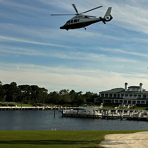 Arnold Palmer leaves the Floridian Golf and Yacht Club in a helicopter during the Devon Quigley Pro-Am at the Floridian.