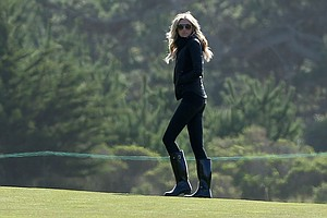 Paulina Gretzky watches the play of Dustin Johnson and her father Wayne Gretzky during the first round of the AT&T Pebble Beach National Pro-Am at the Monterey Peninsula Country Club.