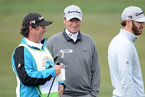 Dustin Johnson, right, and Wayne Gretzky wait in a fairway during the first round of the AT&T Pebble Beach National Pro-Am at the Monterey Peninsula Country Club.