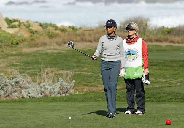 Former Secretary of State Condoleezza Rice chats with her caddie Kathryn Imrie during the second round of the AT&T Pebble Beach National Pro-Am at the Monterey Peninsula Country Club.