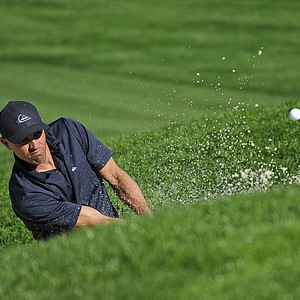World champion surfer Kelly Slater hits from a bunker on the 8th hole during the second round of the AT&T Pebble Beach National Pro-Am at Spyglass Hill.