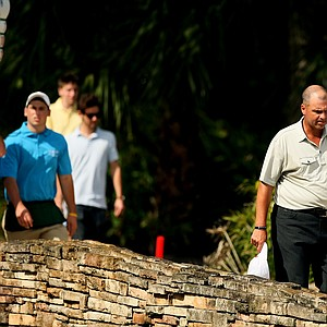 Rocco Mediate and Roger Chapman walk over a bridge at No. 8 during the 2013 Allianz Championship on The Old Course at Broken Sound.