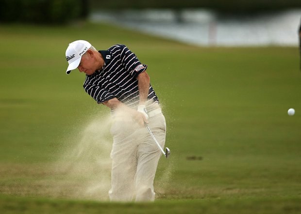 Roger Chapman hits out of the bunker at No. 9 during the 2013 Allianz Championship on The Old Course at Broken Sound.