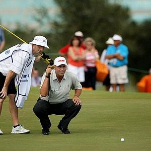 Rocco Mediate talks with his caddie at No. 9 during the 2013 Allianz Championship on The Old Course at Broken Sound.