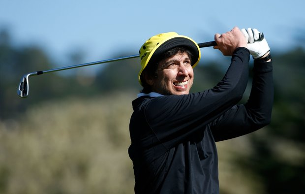 Actor Ray Romano hits a shot on the 17th tee during the third round of the AT&T Pebble Beach National Pro-Am at Pebble Beach Golf Links.