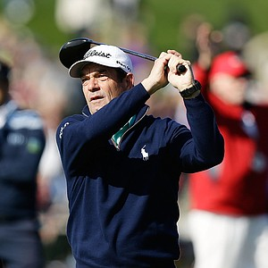 Musician Huey Lewis hits a shot during the third round of the AT&T Pebble Beach National Pro-Am at Pebble Beach Golf Links.