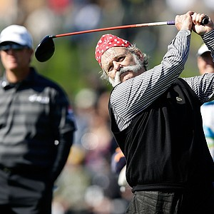 Actor Bill Murray hits a shot as his playing partner D.A. Points looks on during the third round of the AT&T Pebble Beach National Pro-Am at Pebble Beach Golf Links.