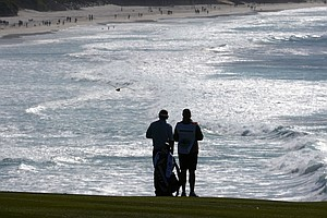 Brandt Snedeker waits with his caddie Scott Vail on the eighth hole as a seagull passes overhead during the final round of the AT&T Pebble Beach National Pro-Am at Pebble Beach Golf Links.