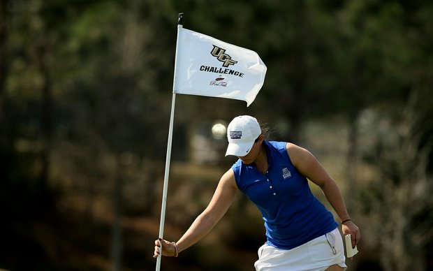 Kimmy Graff of Georgia State puts the pin back in No. 9 during the UCF Challenge at Red Tail Golf Club in Sorrento, Fla. North Carolina won the event, Georgia State finished in 17th place.