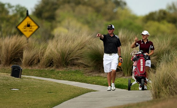 Texas State head coach Mike Akers with Maria Puisite during the UCF Challenge at Red Tail Golf Club in Sorrento, Fla.