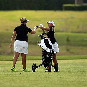 UCF assistant coach Ashley Prange with Paola Robles at No. 18 during the UCF Challenge at Red Tail Golf Club in Sorrento, Fla. UCF placed third.