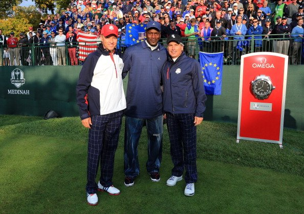 Team Captain Davis Love III, his wife Robin, former Ryder Cup Captain Jack Nicklaus, and NBA Hall of Famer Michael Jordan pose for a photo during the singles matches for the 39th Ryder Cup at Medinah CC.