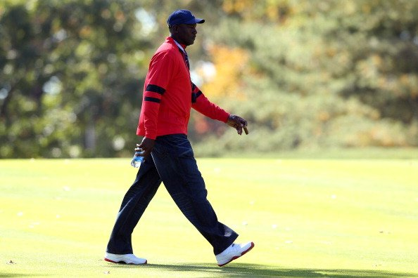 Former NBA player Michael Jordan walks the course during the singles matches for The 39th Ryder Cup at Medinah CC.