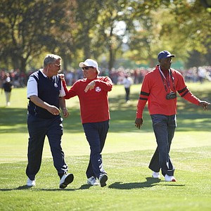 Team USA Fred Couples, centered, and former basketball player Michael Jordan on course during sunday singles matches at Medinah CC for the 39th Ryder Cup.