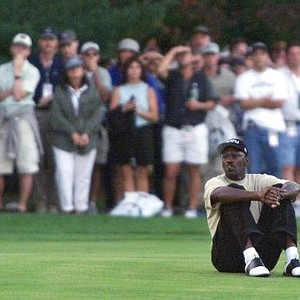 Former NBA player Michael Jordan sits in the middle of the 17th fairway during the four-ball match during the 33rd Ryder Cup at The Country Club.
